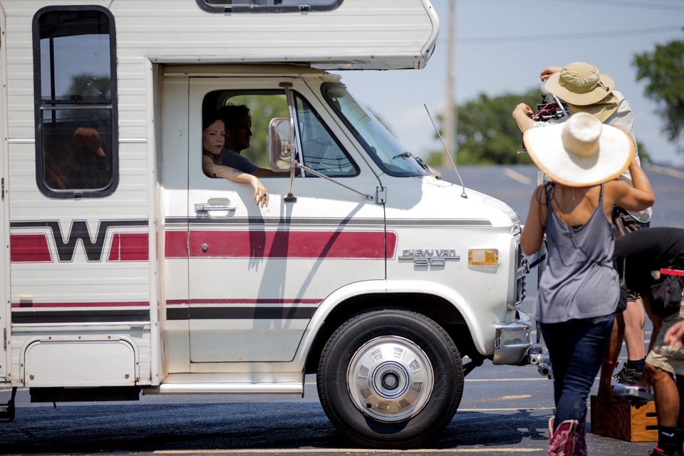 Photo -  Tammin Sursok and Tom Felton wait to film a scene inside a RV on Aug. 3 for the movie