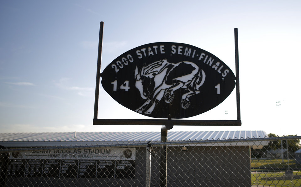 Photo - A sign with the record of Muleshoe High School's 2000 football team is seen outside the stadium in Muleshoe, Texas, hometown of Oklahoma's new offensive coordinator Lincoln Riley, on Wednesday, June 24, 2015. Photo by Bryan Terry, The Oklahoman