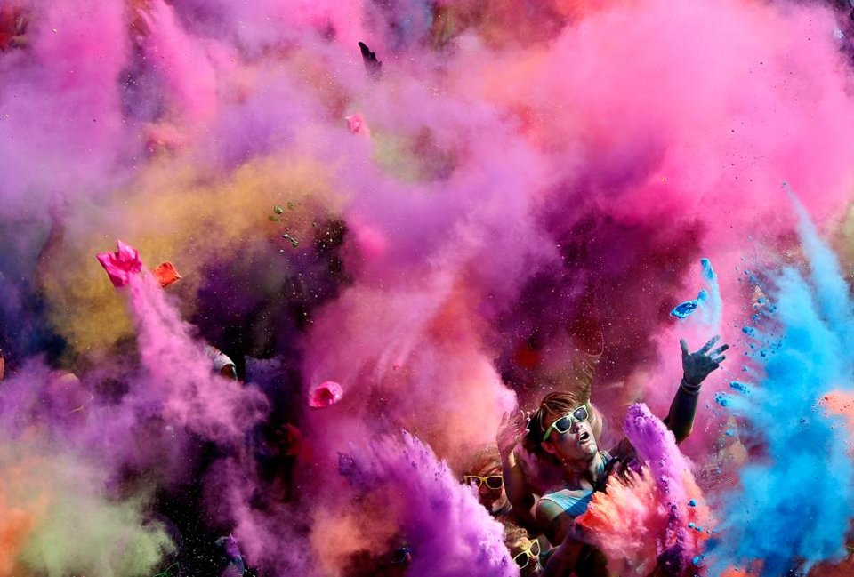 photo a competitor celebrates the finish of the the color me rad 5k at the - Cystic Fibrosis Color