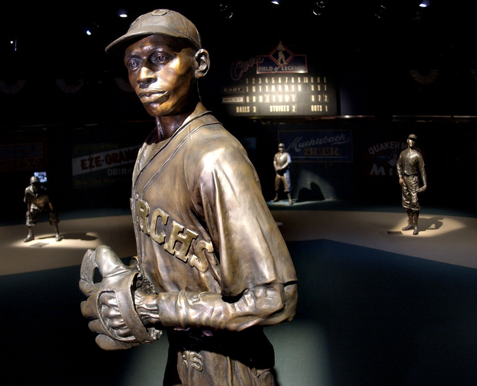 Photo - ** FILE ** In this Jan. 27, 2005 file photo,  bronze statues of Negro League greats including pitcher Satchel Paige, front, play their positions on the Field of Legends, which is the centerpiece of the Negro Leagues Baseball Museum in Kansas City, Mo. Three and a half years after the death of museum founder and ambassador Buck O'Neil, the museum is finding itself on shaky financial ground. (AP Photo/Charlie Riedel, File) ORG XMIT: KSCR104