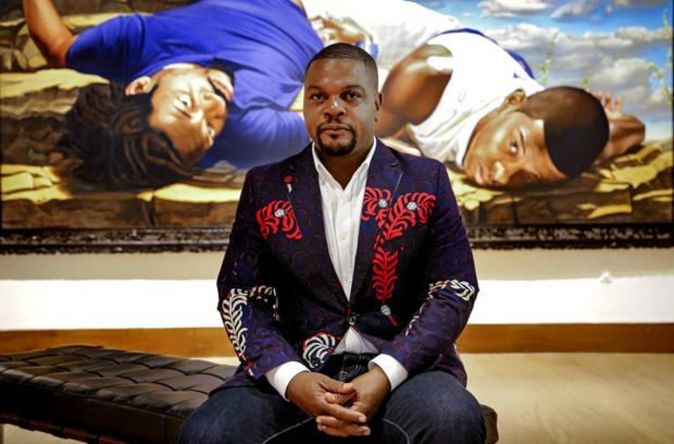 Photo - Artist Kehinde Wiley poses recently for a photo before the opening of his show