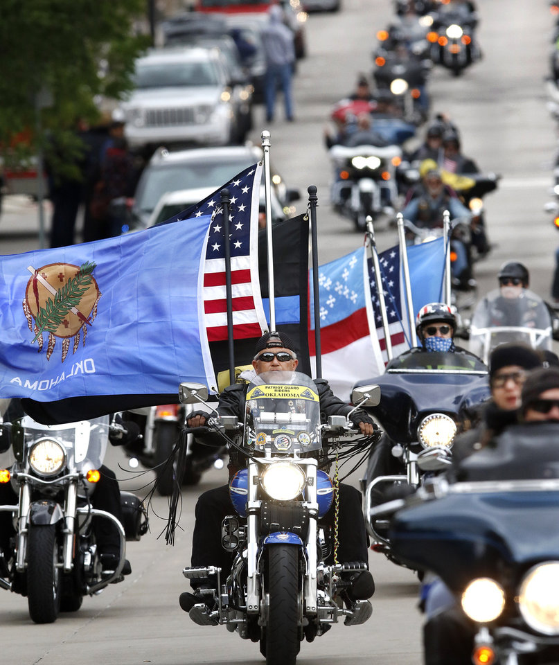 Photo -  Motorcyclists rumbled through the downtown streets of Oklahoma City on Saturday, taking part in the 10th annual Ride to Remember. The annual benefit run honors the 168 people killed in the April 19, 1995, bombing of the Alfred P. Murrah Federal Building. [Photo by Jim Beckel, The Oklahoman]