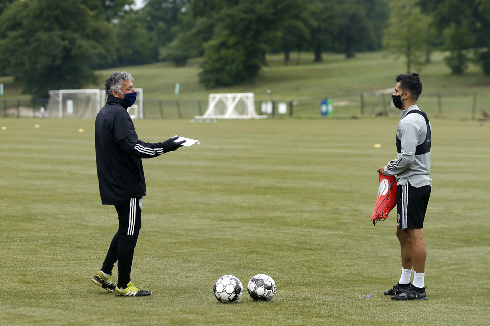 Photo - Energy FC coach Arun Basuljevic talks with player John Pascarella befor soccer practice in Oklahoma City, Wednesday, May 13, 2020. [Bryan Terry/The Oklahoman]