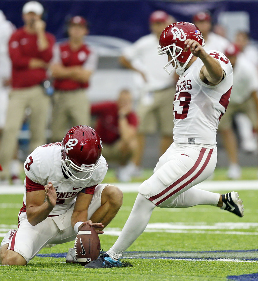 Photo - Oklahoma's Austin Seibert (43) attempts a field goal in the third quarter as Connor McGinnis (3) holds during the AdvoCare Texas Kickoff college football game between the University of Oklahoma Sooners (OU) and the Houston Cougars at NRG Stadium in Houston, Saturday, Sept. 3, 2016. The kick was short and returned by Houston for a touchdown. Houston won 33-23. Photo by Nate Billings, The Oklahoman
