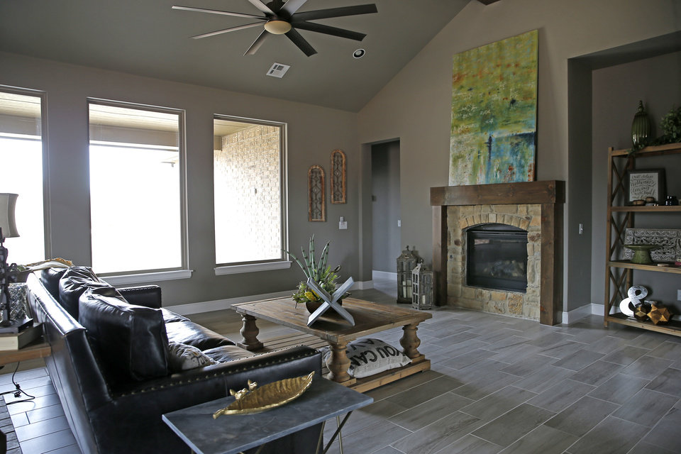 Photo -  Here's the living room at 3208 Hunter Crest, by Alder Fine Homes, in Edmond's Timber Crest addition, the featured neighborhood in the Parade of Homes Spring Festival. [PHOTO BY BRYAN TERRY, THE OKLAHOMAN]