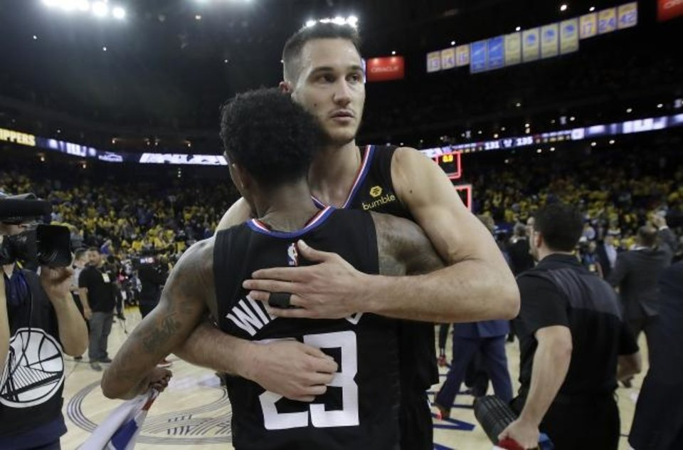 Photo -  Los Angeles Clippers guard Lou Williams and forward Danilo Gallinari celebrate after defeating the Golden State Warriors in Game 2 of a first-round NBA basketball playoff series in Oakland. Gallinari is now a member of the Oklahoma City Thunder. [AP Photo/Jeff Chiu]