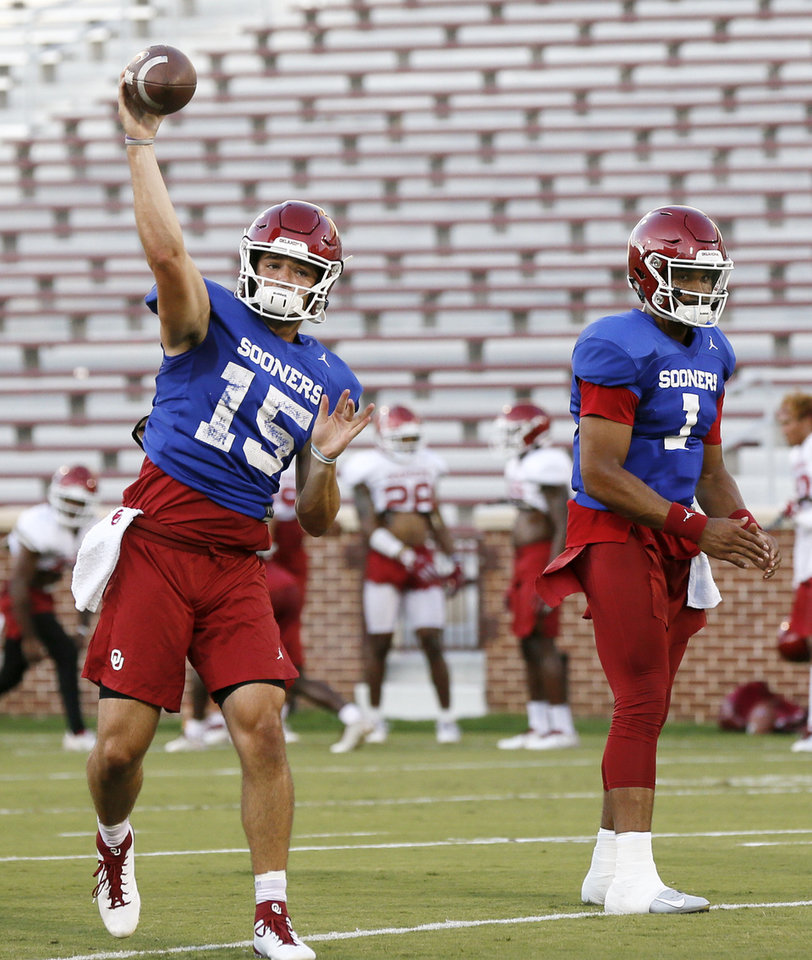 Photo - From left, OU quarterbacks Tanner Mordecai (15) and Jalen Hurts (1) participate in a passing drill during football practice for the University of Oklahoma Sooners at Gaylord Family - Oklahoma Memorial Stadium in Norman, Okla., Monday, Aug. 12, 2019. [Nate Billings/The Oklahoman]