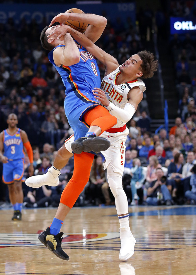 Photo - Atlanta's Trae Young (11) defends against Oklahoma City's Danilo Gallinari (8) during the NBA basketball game between the Oklahoma City Thunder and the Atlanta Hawks at the Chesapeake Energy Arena in Oklahoma City,Friday, Jan. 24, 2020.  [Sarah Phipps/The Oklahoman]
