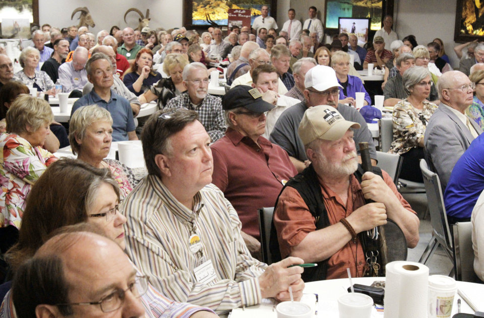 Photo - Club members listen as James Woolsey, former CIA director, speaks to the High Noon Gun Club during their lunchtime meeting at H&H Gun Range in Oklahoma City on Friday. By Paul Hellstern, The Oklahoman