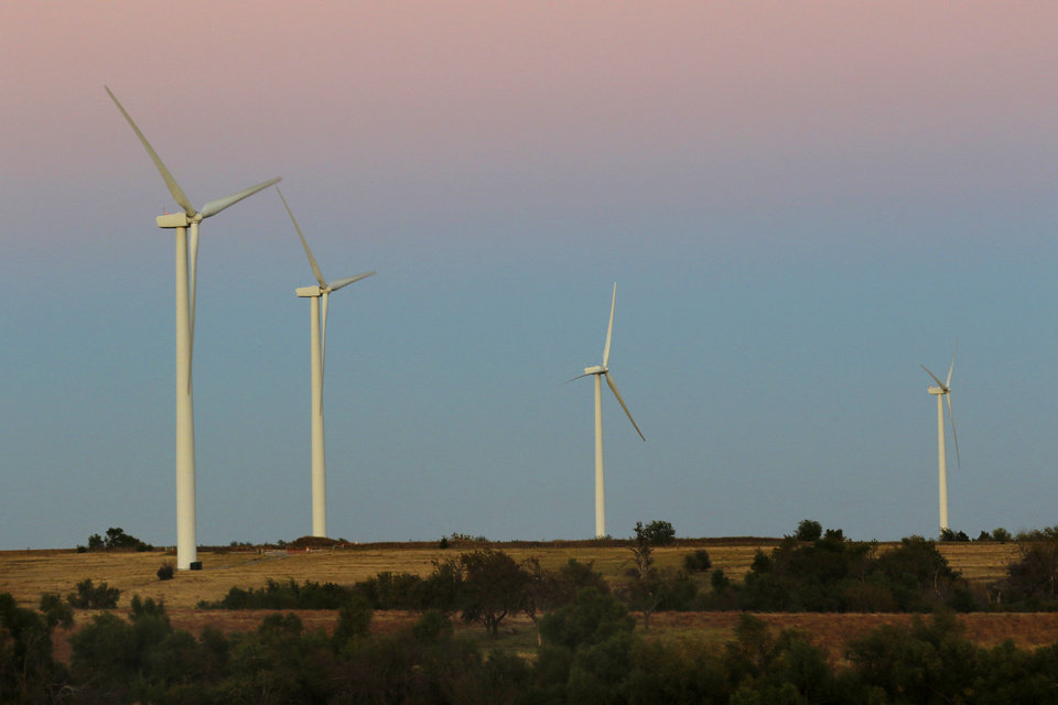 Photo -  Wind turbines west of Minco are pictured in 2016. Wind project developer NextEra is battling considerable opposition to expansion plans it has in the area. [The Oklahoman Archives]