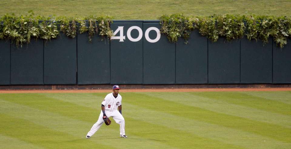 "Photo - RedHawks center fielder Julio Borbon patrols the outfield at AT&T Bricktown Ballpark, which has ivy on the walls like Chicago's Wrigley Field as part of the club's ""Taste of the Big Leagues"" campaign. Photo by Doug Hoke, The Oklahoman"