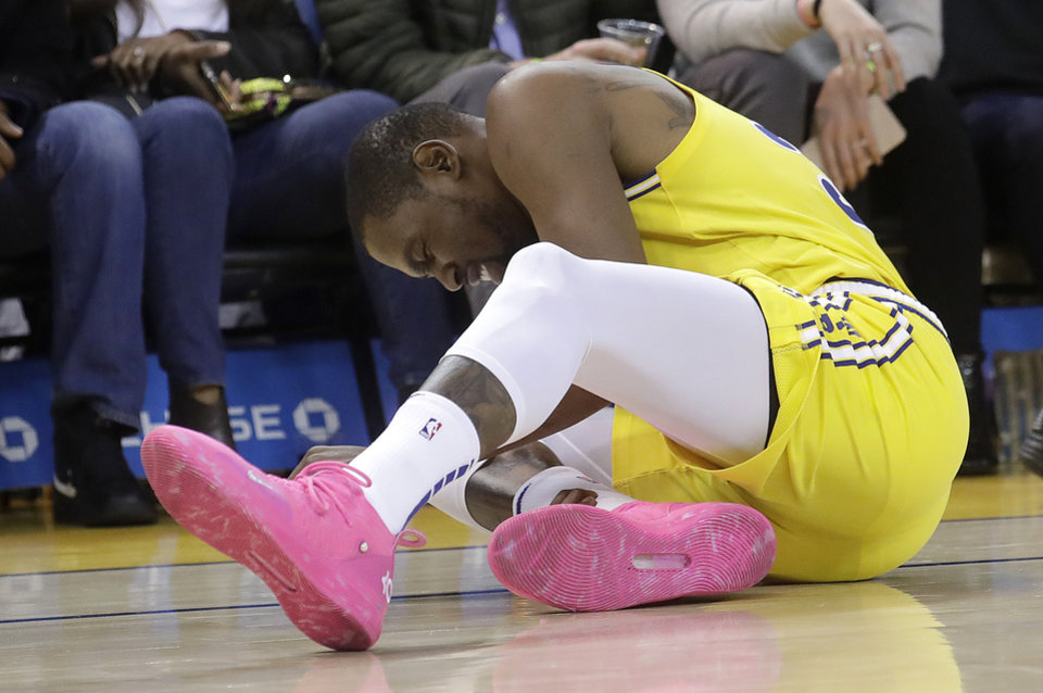 Photo - Golden State Warriors forward Kevin Durant reacts after injuring his ankle during the second half of an NBA basketball game against the Phoenix Suns in Oakland, Calif., Sunday, March 10, 2019. (AP Photo/Jeff Chiu)