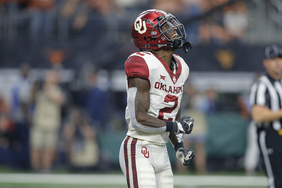 Photo - Oklahoma's CeeDee Lamb (2) celebrates after a touchdown the Big 12 Championship football game between the Oklahoma Sooners (OU) and the Texas Longhorns (UT) at AT&T Stadium in Arlington, Texas, Saturday, Dec. 1, 2018.  Oklahoma won 39-27. Photo by Bryan Terry, The Oklahoman
