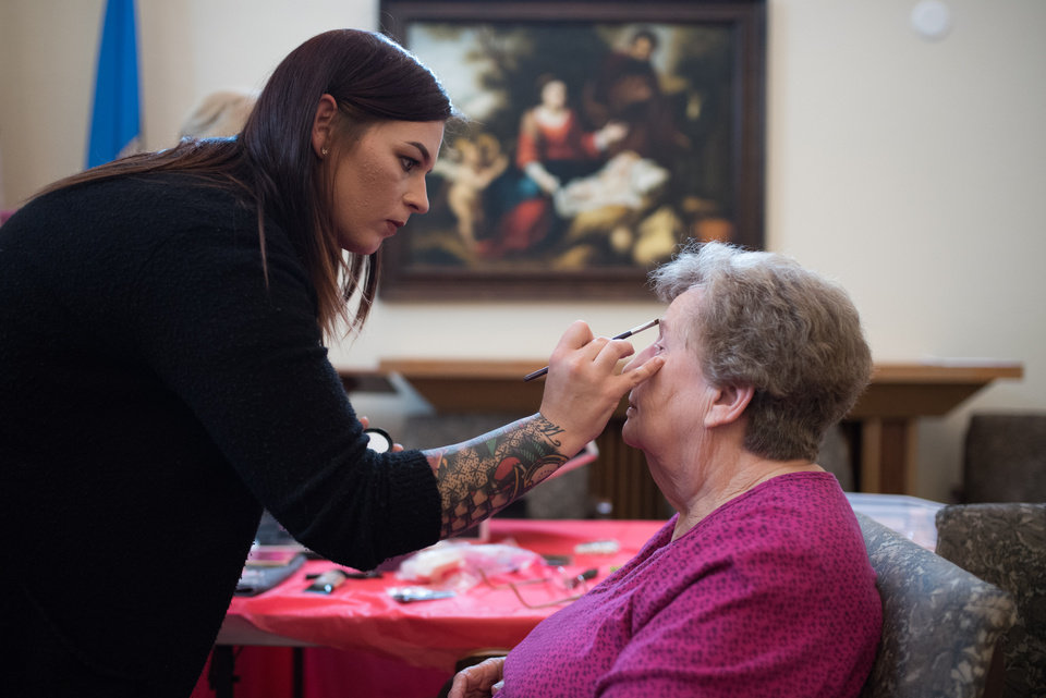 Photo -  Makeup artist Alyxis Nowlin, left, applies makeup to Concordia resident Betty Fisher before the facility's 10th anniversary gala. [PHOTO BY WHITNEY BRYEN, FOR THE OKLAHOMAN]