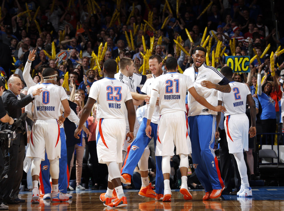 Photo - The Oklahoma City bench celebrates in the final minute of the NBA game between the Oklahoma City Thunder and the Chicago Bulls at Chesapeake Energy Arena in Oklahoma City, Sunday, March  15, 2015. Photo by Sarah Phipps, The Oklahoman
