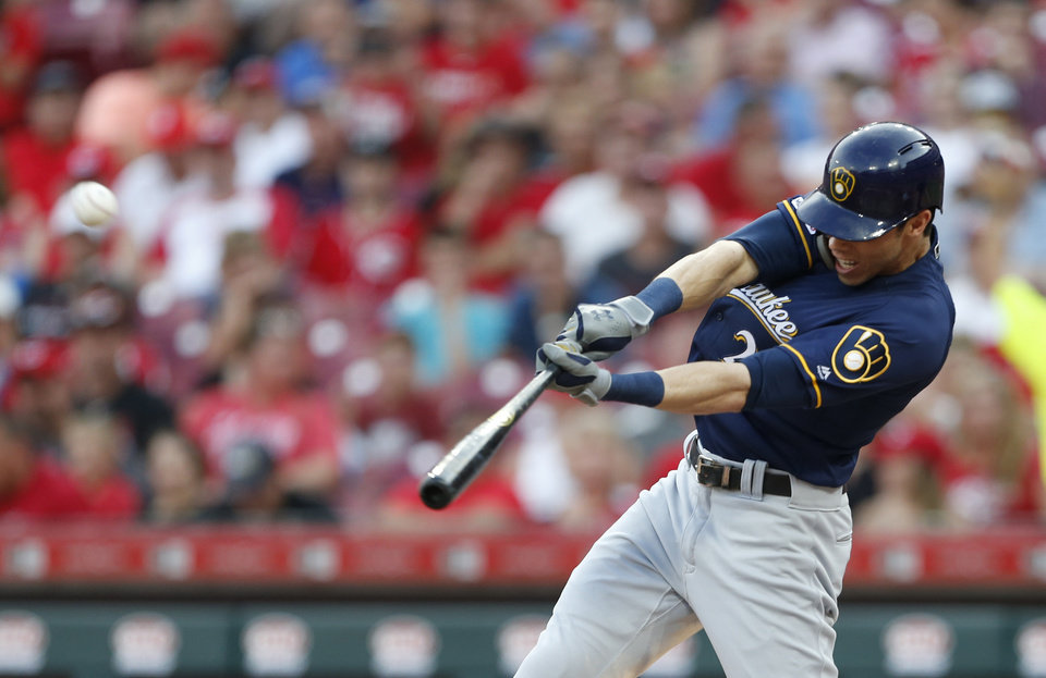 Photo -  FILE - In this July 2, 2019, file photo, Milwaukee Brewers' Christian Yelich hits a solo home run off Cincinnati Reds starting pitcher Tanner Roark during the fourth inning of a baseball game in Cincinnati. Josh Bell and Yelich are among eight competitors in this year's All-Star Game Home Run Derby, which is handing out a $1 million prize to the winner. (AP Photo/Gary Landers, File)