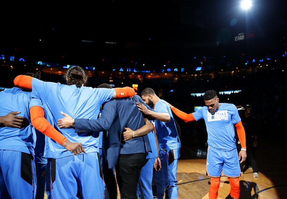 Photo - The Thunder huddle before the NBA game between the Oklahoma City Thunder and the Utah Jazz at the Chesapeake Energy Arena, Friday, Feb. 22, 2019. Photo by Sarah Phipps, The Oklahoman