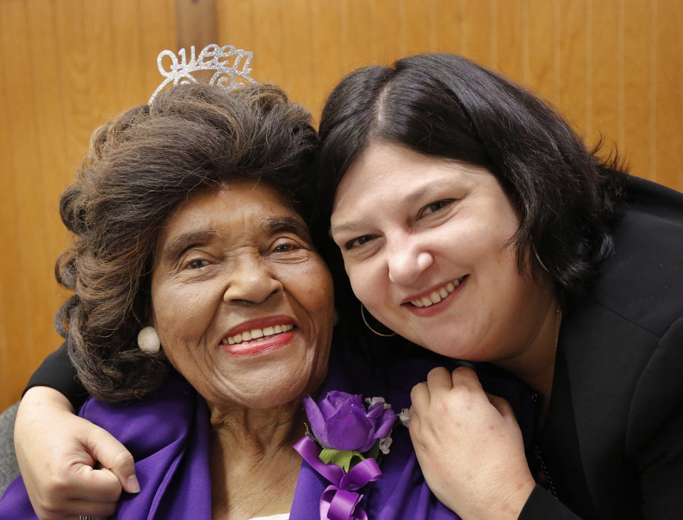 Photo - Thelma Parks is hugged by the current Oklahoma City Public Schools Superintendent Aurora Lora during the assembly. Thelma Parks Elementary School is celebrating its 20th anniversary by honoring Parks, a former teacher and school board member for whom the school is named, and honoring Thurman White Jr., a 2017 Foundation for Oklahoma City Public Schools Wall of Fame inductee who had Parks as a teacher. The event was held  in the school's auditorium on Thursday, Nov. 2, 2017.  Photo by Jim Beckel, The Oklahoman
