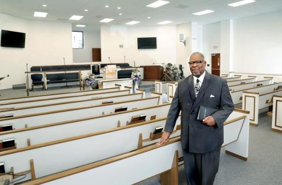 Photo -  The Rev. Frank McClarty, senior pastor of Holy Temple Baptist Church, stands in the church's new sanctuary in northeast Oklahoma City. [Jim Beckel/The Oklahoman]