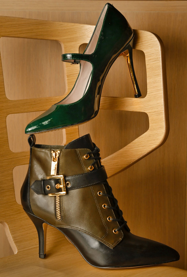 Photo - Vince Camuto emerald patent stiletto with gold heel accent and Michael Kors olive and black buckle bootie from Dillard's, Penn Square Mall. Photo by Chris Landsberger, The Oklahoman  CHRIS LANDSBERGER
