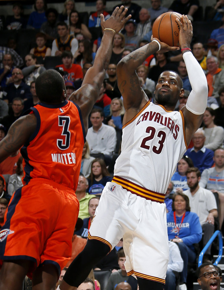 Photo - Cleveland's LeBron James (23) shoots over Oklahoma City's Dion Waiters (3) during an NBA basketball game between the Oklahoma City Thunder and the Cleveland Cavaliers at Chesapeake Energy Arena in Oklahoma City, Sunday, Feb. 21, 2016. Oklahoma City lost 115-92.  Photo by Bryan Terry, The Oklahoman