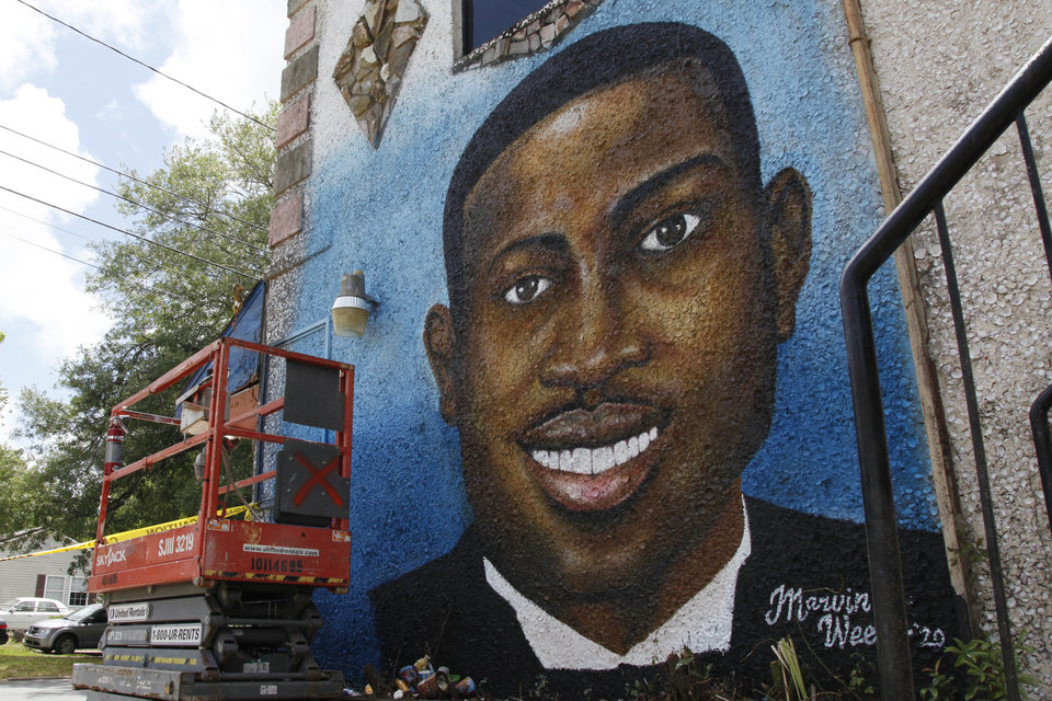Photo -  In this May 17, 2020, photo, a recently painted mural of Ahmaud Arbery is on display in Brunswick, Ga., where the 25-year-old man was shot and killed in February. It was painted by Miami artist Marvin Weeks. (AP Photo/Sarah Blake Morgan)