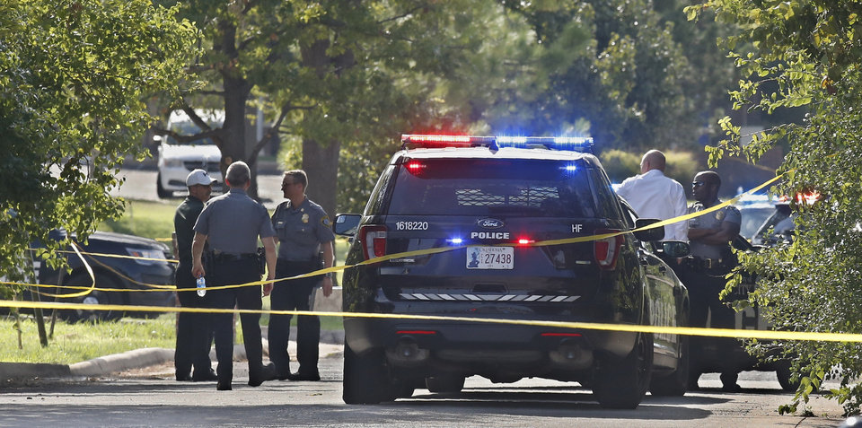 Photo -  Crime scene tape closes off an area where a shooting suspect was fatally shot during a police chase Monday, Sept. 9, 2019, in northwest Oklahoma City. [AP Photo/Sue Ogrocki]