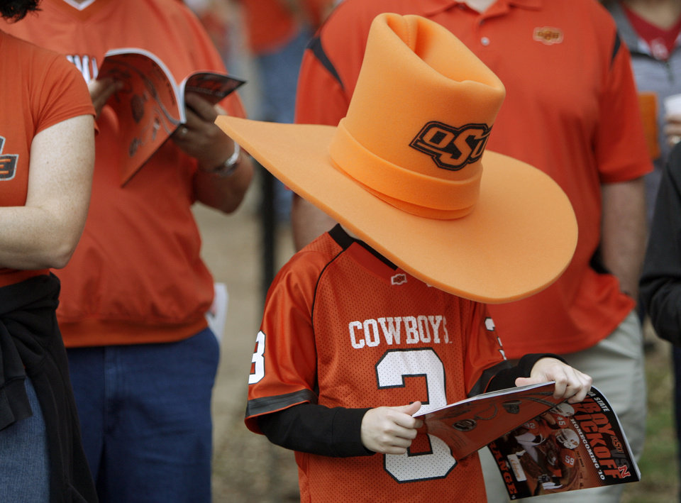 Photo - Gage Milner, 7, of Duke, Okla., waits for the Spirit Walk to begin before the college football game between the Oklahoma State Cowboys (OSU) and the Nebraska Huskers (NU) at Boone Pickens Stadium in Stillwater, Okla., Saturday, Oct. 23, 2010. Photo by Bryan Terry, The Oklahoman