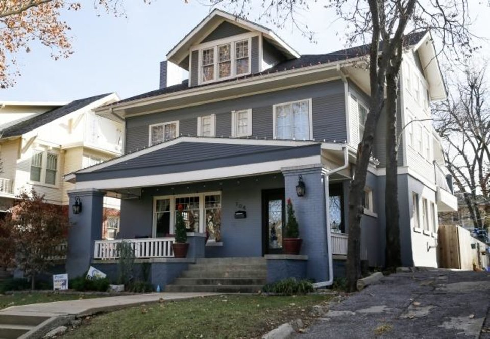 Photo -  Andy and Jennifer Bowman's American Foursquare-style home at 704 NW 18, built in 1912, provided the refreshment porch for the 2019 Mesta Park Holiday Home Tour. [THE OKLAHOMAN ARCHIVES]