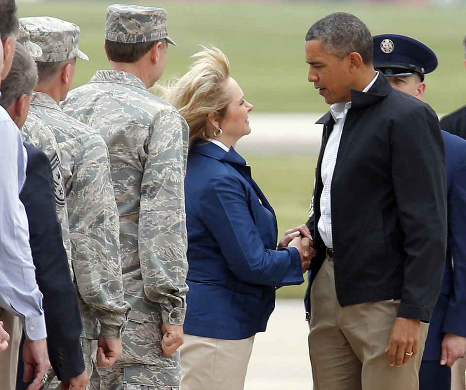 Photo - President Barack Obama greets Gov. Mary Fallin after arriving at Tinker Air Force base in Midwest City, Sunday, May 26, 2013. Obama was in town to visit areas damaged by the May 20 tornado. Photo by Sarah Phipps, The Oklahoman