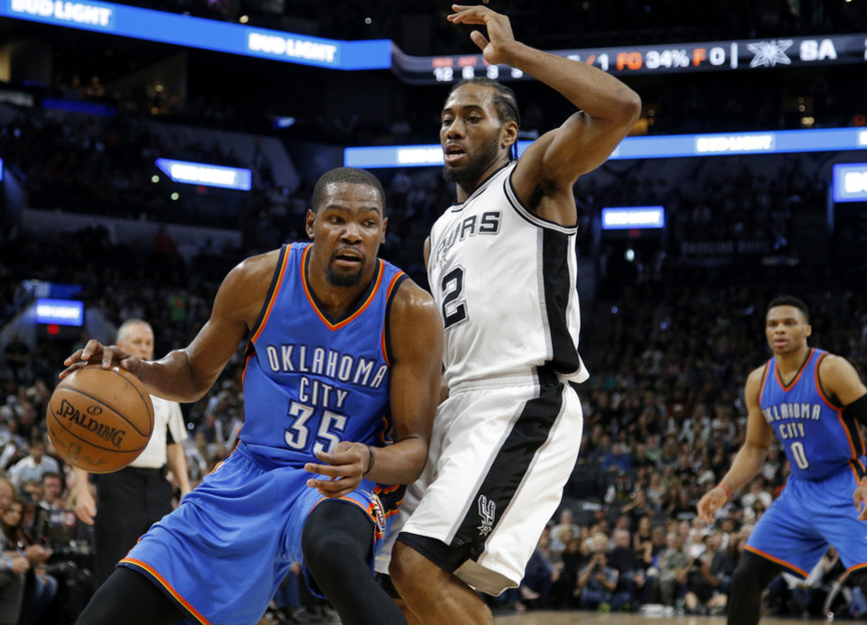 Photo - Oklahoma City's Kevin Durant (35) tries to get past San Antonio's Kawhi Leonard (2) during Game 5 of the second-round series between the Oklahoma City Thunder and the San Antonio Spurs in the NBA playoffs at the AT&T Center in San Antonio, Tuesday, May 10, 2016. Photo by Bryan Terry, The Oklahoman