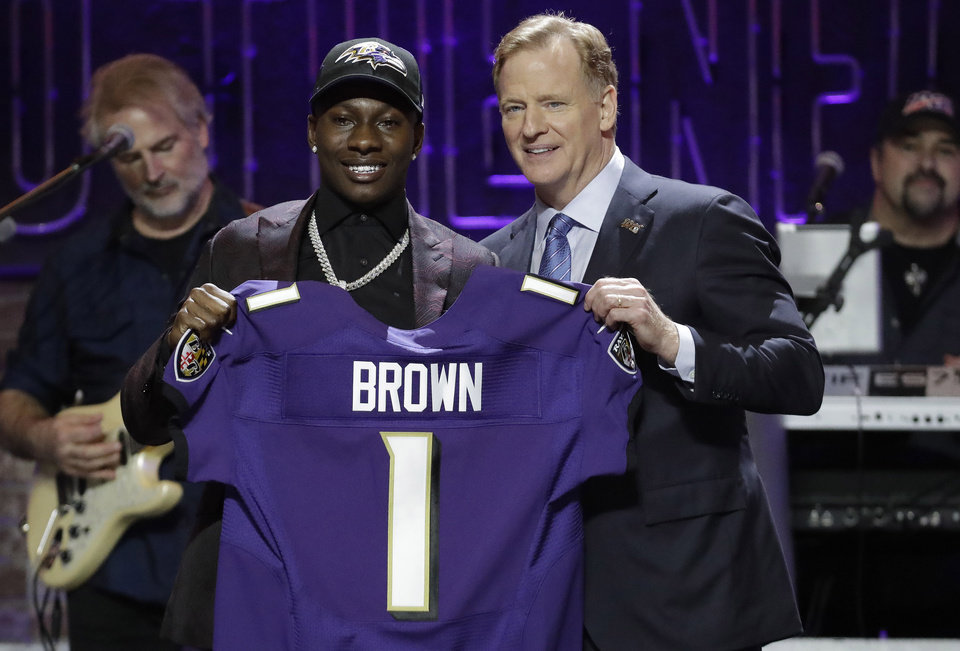 Photo - Oklahoma wide receiver Marquise Brown poses with NFL Commissioner Roger Goodell after the Baltimore Ravens Brown selected in the first round at the NFL football draft, Thursday, April 25, 2019, in Nashville, Tenn. (AP Photo/Steve Helber)