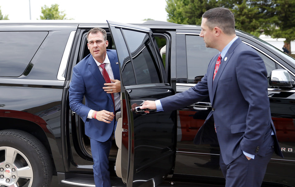Photo - Gov. Kevin Stitt arrives outside BOK to speak to the media before the Trump Rally in Tulsa, Okla., Saturday, June 20, 2020. [Sarah Phipps/The Oklahoman]