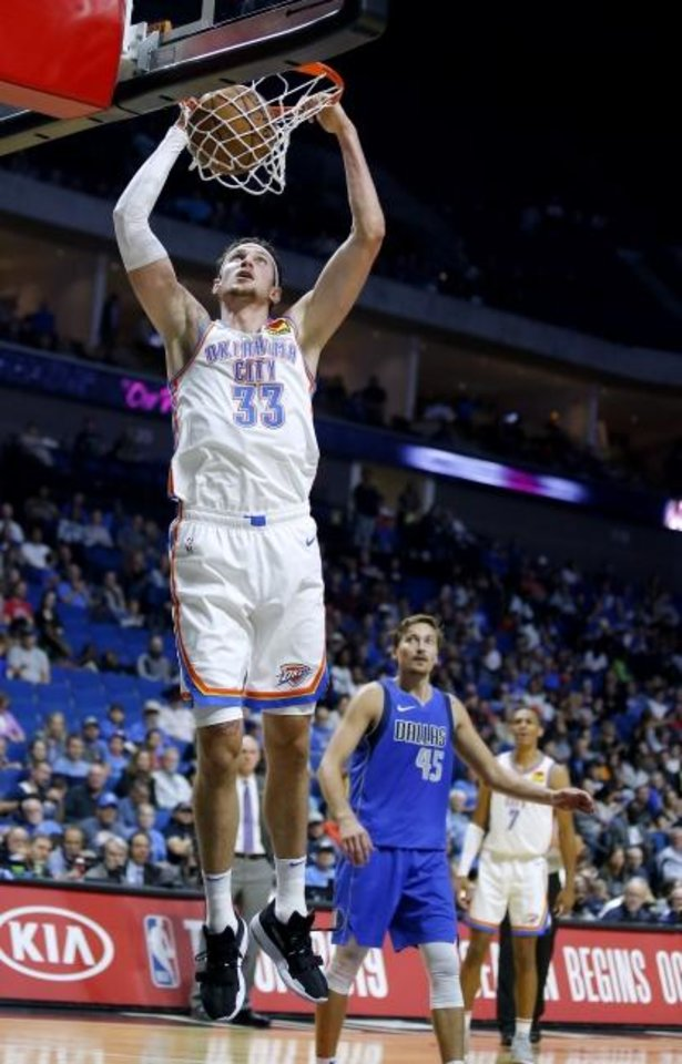 Photo -  Oklahoma City's Mike Muscala goes up for a basket during the preseason. [Sarah Phipps/The Oklahoman]