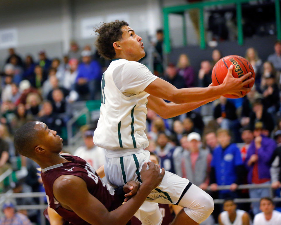 Photo - Norman North junior guard Trae Young goes up for shot against Edmond Memorial's Kristian Doolittle in a recent game. Young is The Oklahoman's Boys Basketball Player of the Week. (Photo by Jim Beckel, The Oklahoman)