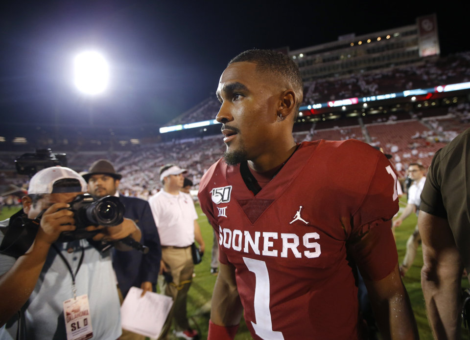 Photo - Oklahoma's Jalen Hurts (1) leaves the field following during a college football game between the University of Oklahoma Sooners (OU) and the Houston Cougars at Gaylord Family-Oklahoma Memorial Stadium in Norman, Okla., Sunday, Sept. 1, 2019. [Sarah Phipps/The Oklahoman]