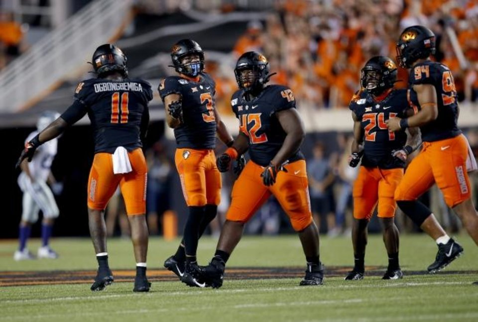 Photo -  Oklahoma State's Amen Ogbongbemiga, left, Tre Sterling, Jayden Jernigan, middle, Jarrick Bernard and Trace Ford, right,celebrate against Kansas State last week. [Sarah Phipps/The Oklahoman]