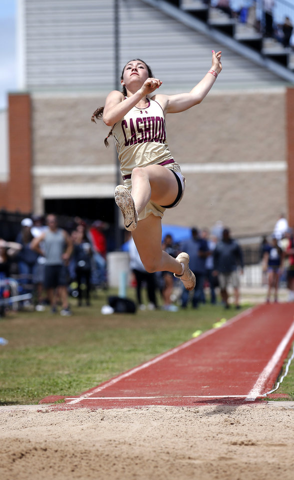 Photo - Cashion's  Madelyn McCabe jumps in the long jump during the Class A and 2A state track and field championship at Western Heights High School in Oklahoma City, Saturday, May 4, 2019. Photo by Sarah Phipps, The Oklahoman