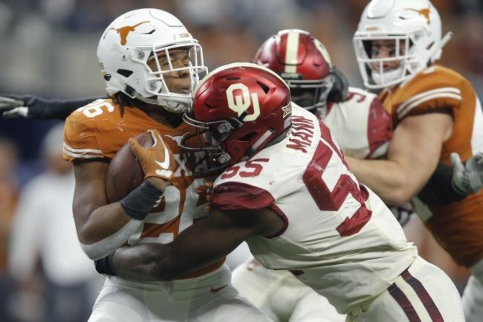 Photo -  Oklahoma's Kenneth Mann (55) started 13 games a season ago and was a captain but was nowhere on the first two-deep of the season. [Bryan Terry/The Oklahoman]