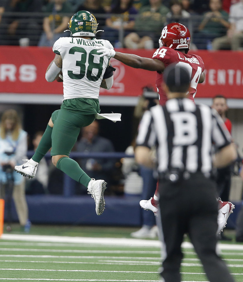 Photo - Baylor's Jordan Williams (38) intercepts a pass intended for Oklahoma's Lee Morris (84) during the Big 12 Championship Game between the University of Oklahoma Sooners (OU) and the Baylor University Bears at AT&T Stadium in Arlington, Texas, Saturday, Dec. 7, 2019. [Bryan Terry/The Oklahoman]