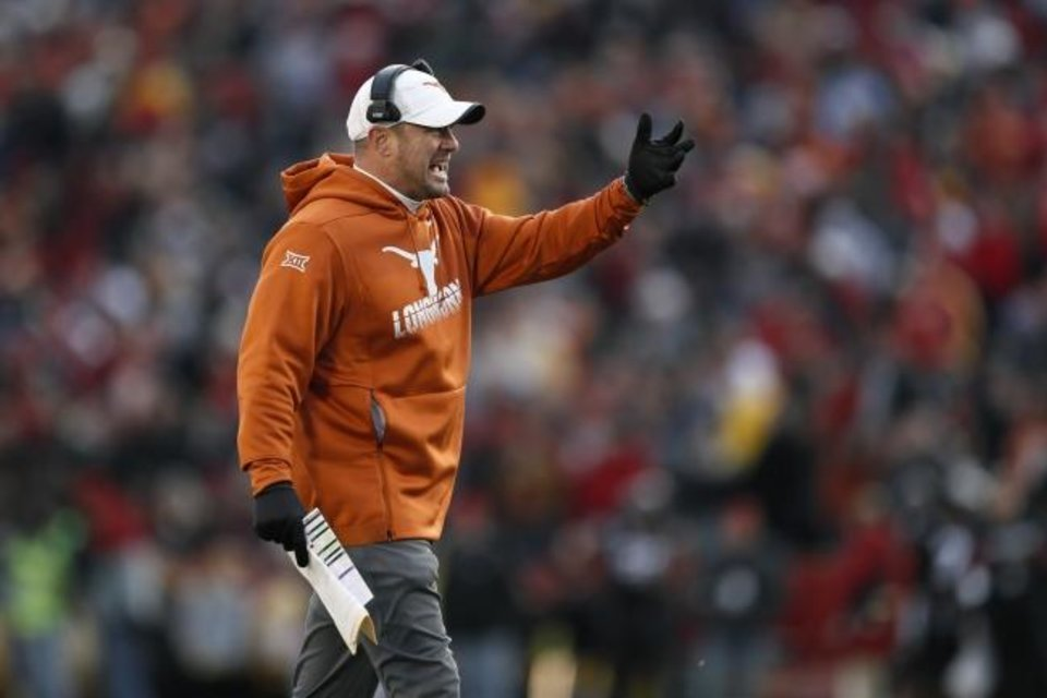 Photo -  Tom Herman shook up his coaching staff Sunday and now must hire new offensive and defensive coordinators. After a disappointing season, the Texas head coach must make good hires and get better results, or the next change may involve Herman. [AP PHOTO/CHARLIE NEIBERGALL]