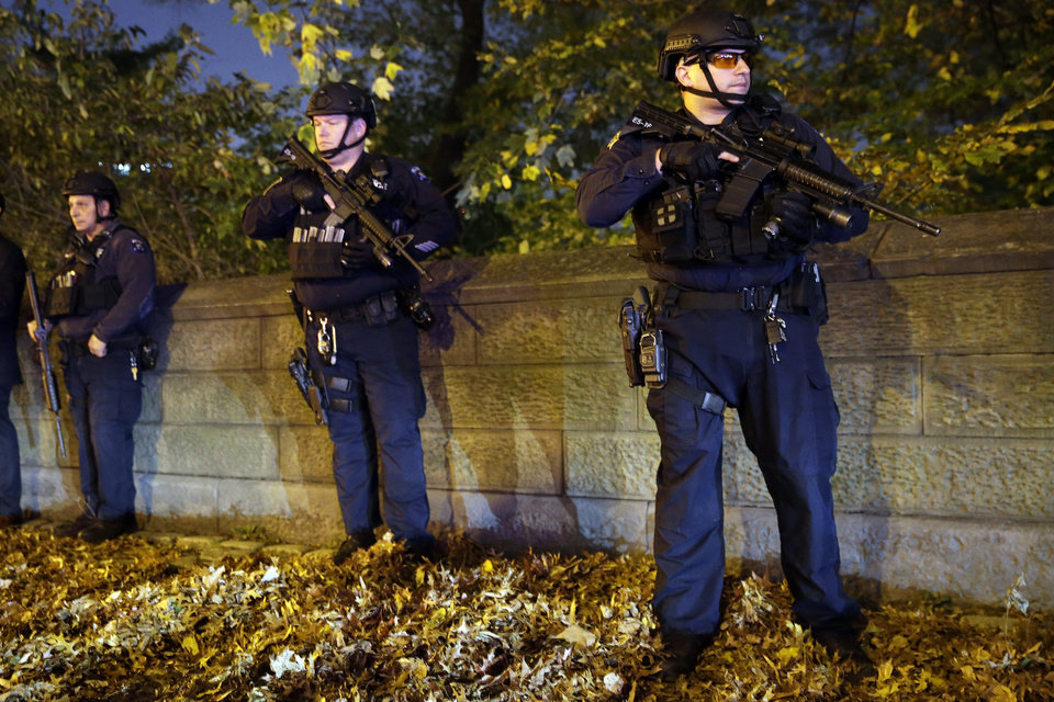 "Photo - Heavily armed New York City police officers stand guard across the street from the French consulate on New York's Fifth Ave., Friday, Nov. 13, 2015. Police in New York say they've deployed extra units to crowded areas of the city ""out of an abundance of caution"" in the wake of the attacks in Paris, France. A New York Police Department statement released Friday stressed police have ""no indication that the attack has any nexus to New York City.""(AP Photo/Mary Altaffer)"