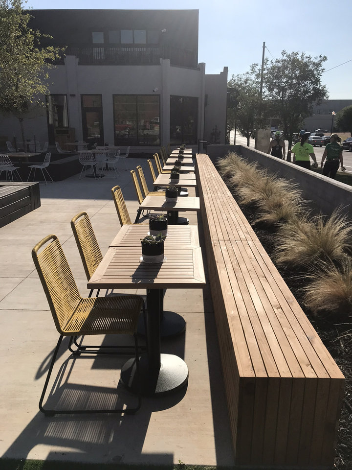 Photo - A look at the patio of The Collective, a new food hall in Midtown. [Dave Cathey/The Oklahoman]