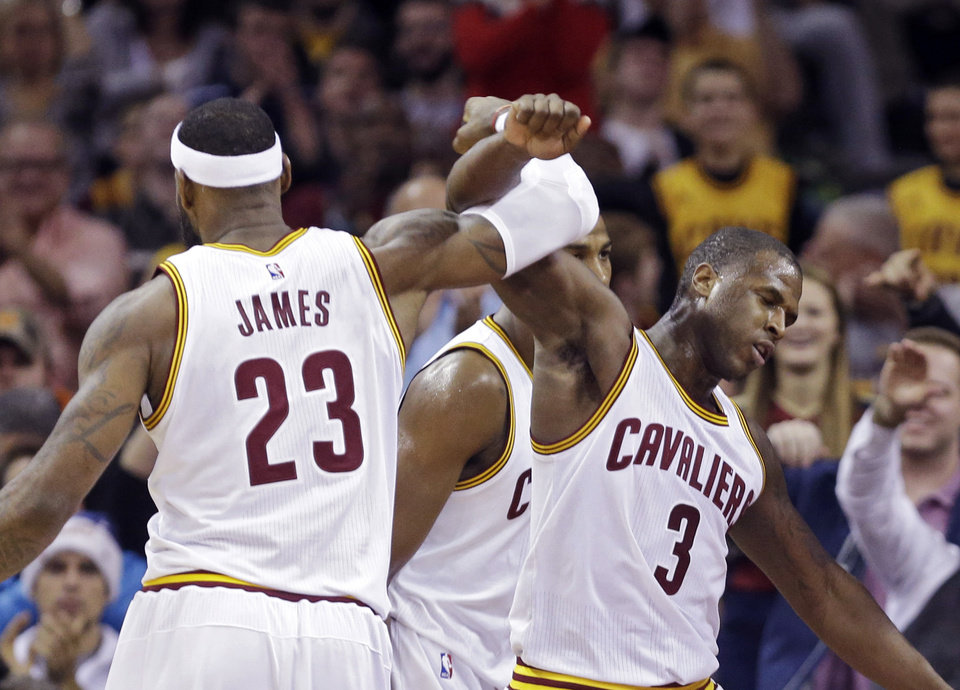 Photo -  Cleveland Cavaliers' LeBron James (23) celebrates with Dion Waiters (3) in the fourth quarter of an NBA basketball game Sunday, Dec. 21, 2014, in Cleveland. The Cavaliers won 105-91. (AP Photo/Mark Duncan)