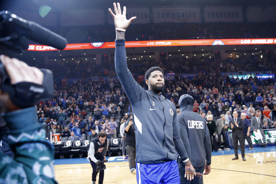 Photo - Paul George of the LA Clippers waves to the crowd during introductions during an NBA basketball game between the Oklahoma City Thunder and the LA Clippers at Chesapeake Energy Arena in Oklahoma City, Sunday, Dec. 22, 2019. Oklahoma City won 118-112. [Bryan Terry/The Oklahoman]