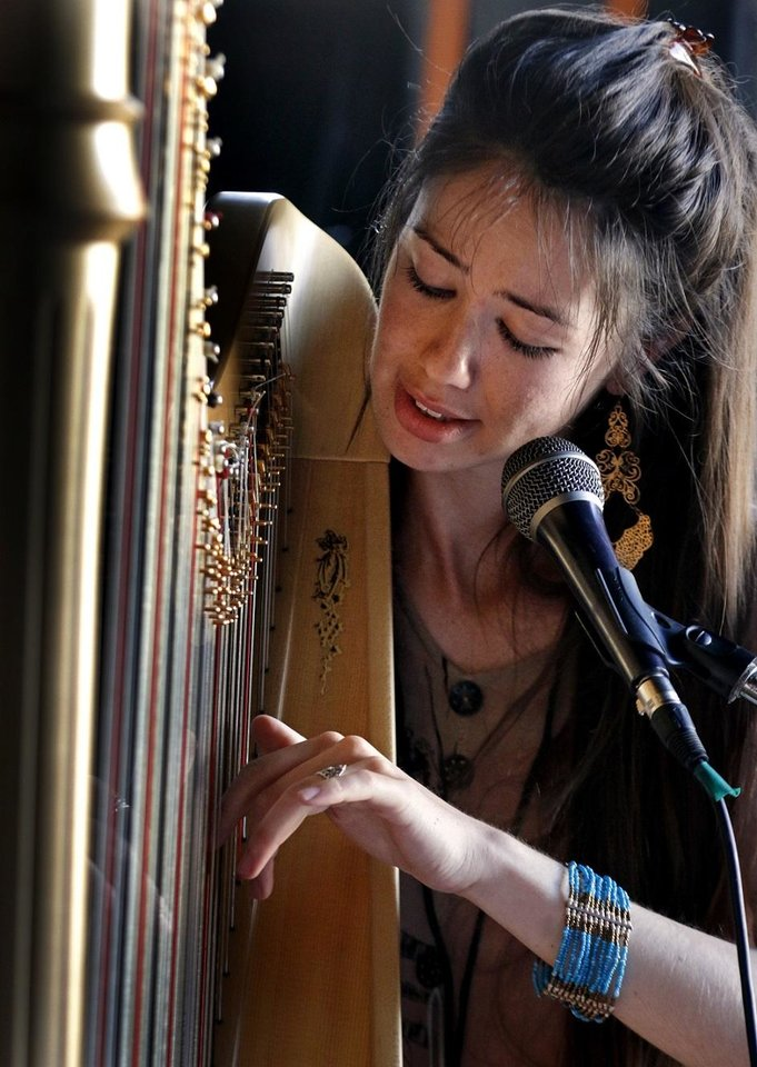 Photo - Yiskah performs on the harp during Norman Music Festival 2019 on April 27, 2019 in Norman, Okla.  [Steve Sisney/For The Oklahoman]