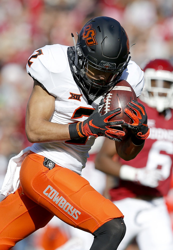 Photo - Oklahoma State's Tylan Wallace (2) makes a catch in the first quarter during a Bedlam college football game between the University of Oklahoma Sooners (OU) and the Oklahoma State University Cowboys (OSU) at Gaylord Family-Oklahoma Memorial Stadium in Norman, Okla., Nov. 10, 2018.  OU won 48-47. Photo by Sarah Phipps, The Oklahoman