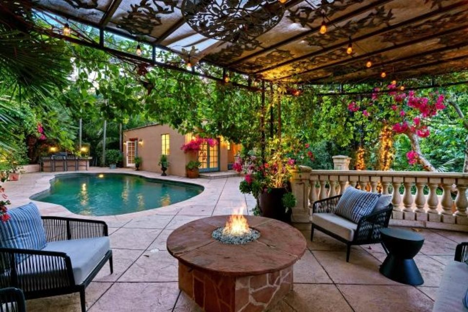 Photo -  Courtyards, patios and a swimming pool with a separate pool house fill out the grounds of Kunal Nayyar and Neha Kapur's compound. [TNS PHOTO]