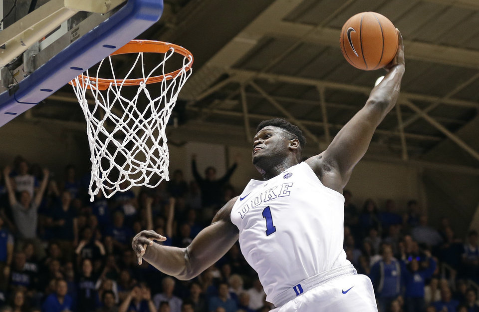 Photo -  In this Jan. 5 photo, Duke's Zion Williamson (1) dunks during the second half of a game against Clemson in Durham, N.C. [Associated Press File Photo]