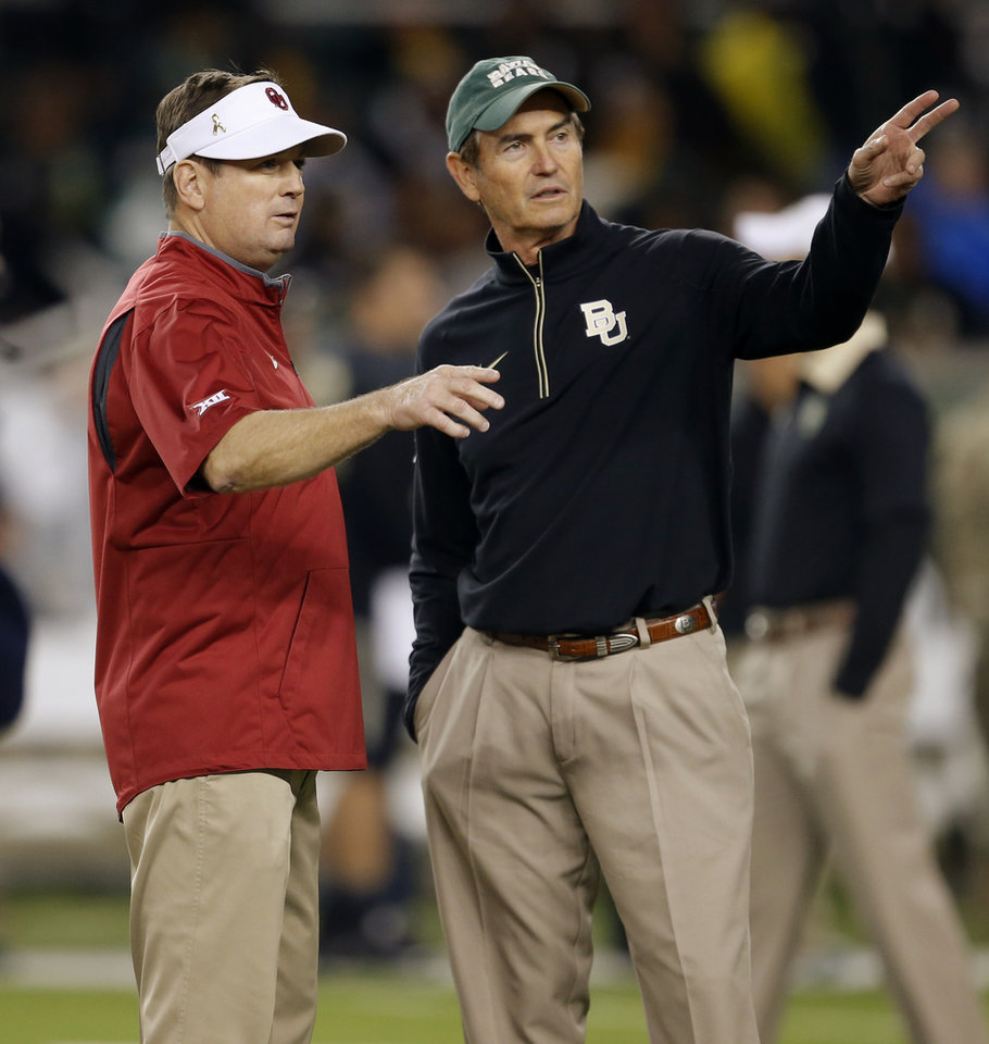 Photo - Oklahoma coach Bob Stoops and Baylor coach Art Briles talk before a college football game between the University of Oklahoma Sooners (OU) and the Baylor Bears at McLane Stadium in Waco, Texas, on Saturday, Nov. 14, 2015. Photo by Bryan Terry, The Oklahoman